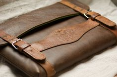 Made out of an vintage bavarian suspender and new leather. Every single Notebook Sleeve is unique.