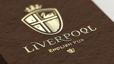 Liverpool English Pub. Contributed by Alexander Andreyev of Ukraine-based Reynolds and Reyner. Liverpool English Pub is the first classic English pub in Ukraine. We started with an analysis of the history and key elements of the town's name and logo. Three main elements that needed to be combined in the logo: the Liver bird, location near the sea, and a heraldic style used in Britain during the birth of Liverpool.