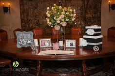 This entryway table features photos of the couple, flowers, a guestbook and custom made car box. #flowers #welcome #signin