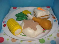 Our felt food fried chicken dinner set, fried drumstick, mashed potatoes with butter patty and gravy, green beans, corn on the cob, carrot cake - getting hungry yet? :)