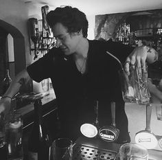 He's holding four glasses... WITH JUST FOUR FINGERS! LIKE BRO HE SHOULD LIKR STOP HIS JUGGLING AND SINGING RN AND BE ONE OF THOSE MEXICAN WAITERS THAT CAN HOLD ALL OF THE PLATES AND GLASSES AND LOOK COOL WHILE DOING SO! K, I'm done now