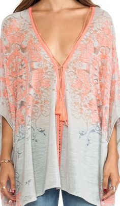 Free People. Cute, but some of us would wear a bra under this.