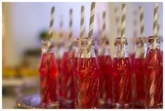 Pink soda with paper straws in glass pop bottles, wedding decor, 2011 Calgary Bridal Expo.
