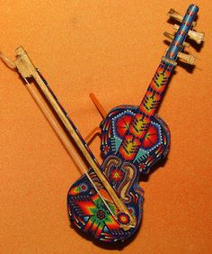 Functional and beaded violin, via Flickr. Seen at The Smithsonian's American Indian Museum.