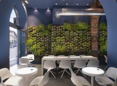 todd bracher blends luscious nature, biological lighting and advanced charging stations to provide an urban oasis with humanscale's 'RE:CHARGE café' during milan design week 2017.