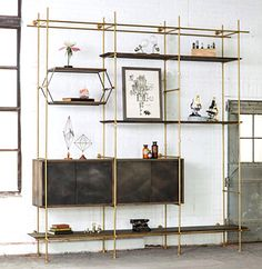 "3 Bay System with Credenza  (As Shown) Shelves: 6'-6"" and 10' shelves, with Knife Edge Detail, in a staggered configuration. Strap Shelves: ..."