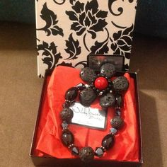 Black Red Stretch bracelet NWB. never wore. Excellent condition. Box included with purchase. From the Wildflower Boutique in Roscoe, Texas! Boutique Jewelry Bracelets