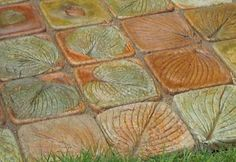 Hosta leaf pavers. Use leaves in plastic food storage container as mold. Acid stains.