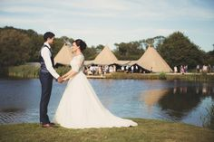 Beautifully simple, rustic & countryside charm for Anna and James' tipi wedding alongside the lakes of Duncton Mill Fishery in West Sussex. Handmade wooden signs, home sourced Italian wine and jam jars saved up by the wedding guests - amazing. Tipis by Beautiful World Tents, photography by zarapricephotography.com