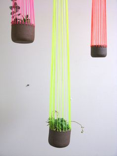 Eye-catching hanging planters with neon strong. Love the modern take on a classic ceramic planter.
