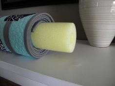 "Use a swim ""noodle"" to roll your quilt around--no creases!  So smart!  Easier for packing and transportation???"
