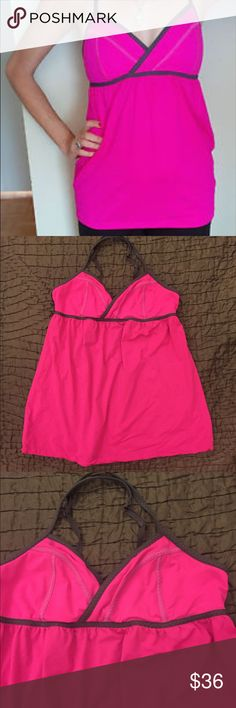 "Lululemon Hot Pink Yoga Workout Bra Top Adorable hot pink and gray Lululemon yoga bra top. Supportive adjustable straps and a built in bra. Very clean and flawless. Size 10 in great condition. 27"" long 15"" across the bust lululemon athletica Tops Tank Tops"