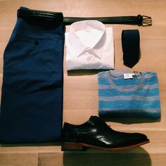 Stylish looks available @Boutique Tozzi Shirt: @Filippa K Pullover: @Sunspel Tie: @Filippa K Pants: @Filippa K Shoes: @Cole Haan