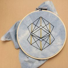 Geometric embroidery on indigo dyed cotton. ⠀ .⠀ .⠀ #naturaldyes #indigodye #modernembroidery #wip #embroidery #abstractart #hoopart #textileart #etsyshop
