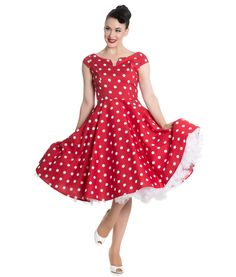 Beautiful 50s style polka dot dress.  Fitted bodice with  flattering boat…