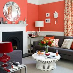 don't like that table & red lamp but the wall color & couches are really nice.