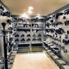 Discover the top 100 best gun room designs featuring cool armories you'll want to acquire. Explore traditional cabinetry to modern shelving security. Hidden Gun Storage, Weapon Storage, Nerf Gun Storage, Weapons Guns, Guns And Ammo, Zombie Weapons, Airsoft Guns, Man Cave Guns, Man Caves
