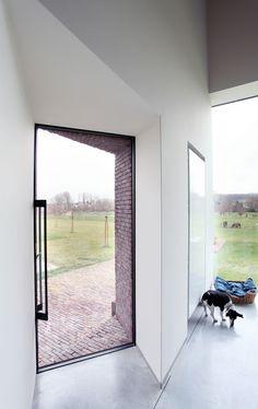 Woning en dierenartsenpraktijk te Gaasbeek: Ramen met uitzicht op de natuur, koeien, weiland,...