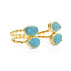 $52.00 Raina Cuff  Twisted gold cuff with four bezel set turquoise stones set this bracelet apart. Coordinates with Ramana gold and turquoise earrings.  - Gold vermeil, turquoise stones