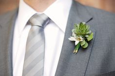 Google Image Result for http://wedding-pictures-02.onewed.com/17801/dapper-groom-grey-suit-formalwear-eco-friendly-boutoinniere-succulents-wedding-flowers.jpg
