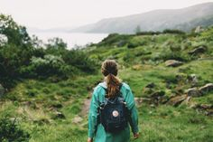 Backpack in her shoulders, the rolling hills ahead, she looked at the path before her with bright eyes and an open mind.
