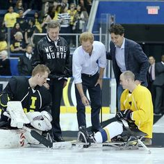 Prince Harry takes part in the ceremonial puck drop at a demonstration sledge hockey game, alongside the Canadian Prime Minister and Mayor of Toronto. The sport will feature at the Invictus Games Toronto 2017.