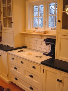 Baking station - how awesome is that?!? I wonder if a Hoosier would work? I like bringing furniture into the kitchen.