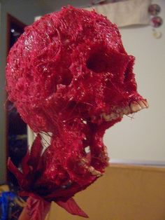 Hot glue corpsing. I have done this although messy the results are perfect for cheap props to hide their lack of realistic gore.