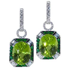 Earrings set with peridot, emerald and diamond to represent family birthstones - August, May and April #oneofakind #mingjewellery