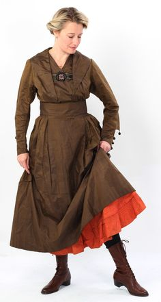 "Lucy Adlington models a WW1 brown silk day dress and orange cotton petticoat for History Wardrobe and ""Great War Fashion"""