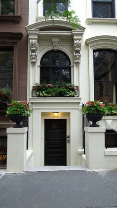 Brooklyn Brownstone and a beautiful display of a window box and urns.