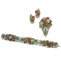 Gem set and diamond parure, Comprising: a bracelet, brooch and earrings, each designed as floral bouquets set with calibré-cut gemstones including emeralds, amethysts, sapphires, citrines and rubies, brilliant- and single-cut diamonds