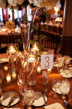 Gold Linens | Burnt Orange Linens| Floating Candles| Table Numbers | Bouquets of Austin | Marquee Event Group | The Driskill | Kristi Wright Photography | Pearl Events Austin