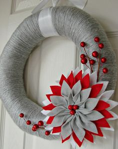 Holiday yarn wrapped wreath with large flower. $30.00, via Etsy.