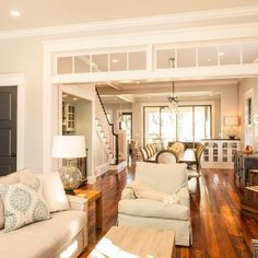 Classic Traditional Living Room. Newly decorated such a superb job I love the transom window and the flow from one room to another that's why you hire a pro