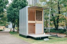 With a footprint of just 106 square feet, this Muji Hut prefab unit by German designer Konstantin Grcic makes a case for tiny, vertical living. The exterior is made from aluminum and wood.