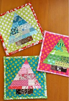 Christmas Tree Mini-Quilts or Hot Pads Quilted art for your holiday table! A Pink Chalk Studio Pattern by Kathy Mack  Easy to Advanced Holiday Kitchen Sewing Projects - sew-whats-new.com