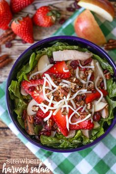 Strawberry Harvest Salad - tastes just like the salad at Zupa's! It's topped with apples, strawberries, chicken, candied pecans, cheese and a homemade Strawberry Vinaigrette dressing.