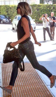 Who amde Lauren Conrad's stripe loafers, blue skinny jeans, and black leather handbag?