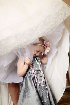 Adorable! Great picture idea, and such a cute way to dress the flower girl! She can feel like a princess too with all those pearls and bling. :)