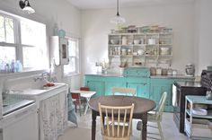 Vintage kitchen remodel before and after. Farmhouse sink, white and cream floor, aqua cabinets