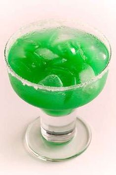 Kiss Me, I'm Irish 1 parts Hornitos Plata Tequila 1 part DeKuyper Island Blue Tropical Schnapps 1 part Pineapple Juice 1 part Mango Juice Shake with ice and strain into a martini glass. Irish Cocktails, Cocktail Drinks, Fun Drinks, Yummy Drinks, Cocktail Recipes, Alcoholic Drinks, Beverages, Drink Recipes, Tequila