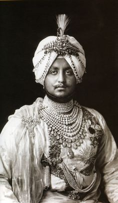 Maharaja Bhupendra Singh of Patiala wearing his fourteen strand natural pearl necklace and royal jewels.