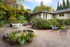 Originally built in 1953, the property was designed with forethought to today's lifestyle using a unique floor plan centered on an inviting patio and magnificent fountain.