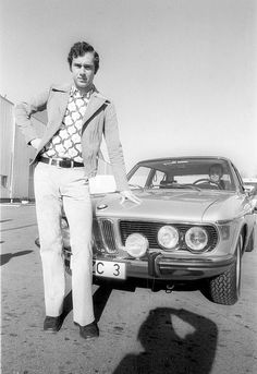 Franz Beckenbauer stands in front of his new car, a BMW Automatic, in Nicknamed Der Kaiser, he played for West Germany more than 100 times. He was with Bayern Munich between 1964 and helping them to three successive European Cup wins in the German Football Players, Soccer Players, Kenny Dalglish, Bmw E9, Football Images, Kicker, Auto Motor Sport, Classic Mercedes, Best Player