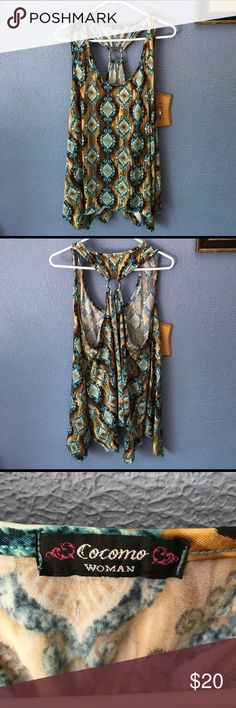 """Shark Bite Tank Reposh- no tag but it is a polyester/spandex blend and has a metal o-ring in the racerback.    The bust measures about 23"""" and the length is about 29"""" from the shoulder seam to the short point of the hem. Cocomo Woman Tops Tank Tops"""