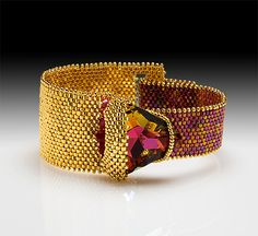 Baltic Gems Bracelet 2008  No Tutorial, but this is a great variation on the beaded cuff concept.,  Should be possible to reproduce with enough planning.