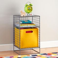 To keep things from getting too matchy, I'd suggest an alternative nightstand. This grey grid nightstand has clean lines, and brings another materials into the story. It also won't take up a lot of space, but has plenty of storage for books and toys. I also like it with the yellow felt bin.