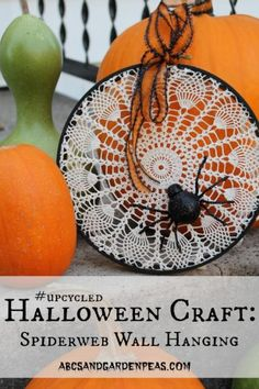 Easy upcycled Halloween craft: Spiderweb Wall Hanging using an old doily!