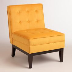 The cheery yellow-orange hue of our cozy chair adds a brilliant note to any living space. With a boxy silhouette, tufted cushions and piping, it's a modern take on the classic slipper chair.